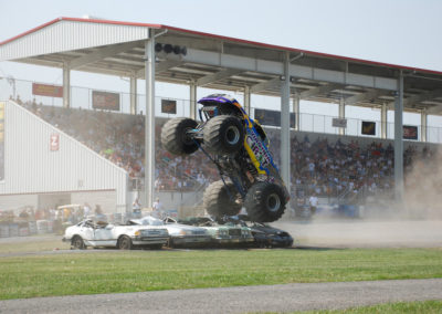 the virginia giant monster truck crushing cars and in the vertical position