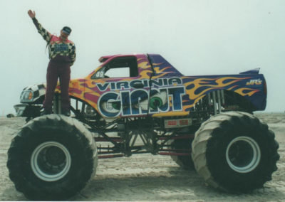 Diehl Wilson standing on the front tire of the virginia giant waving