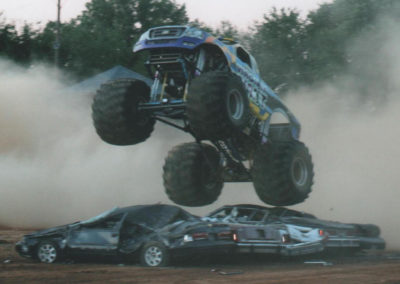 virginia giant monster truck crushing cars with dust in the background
