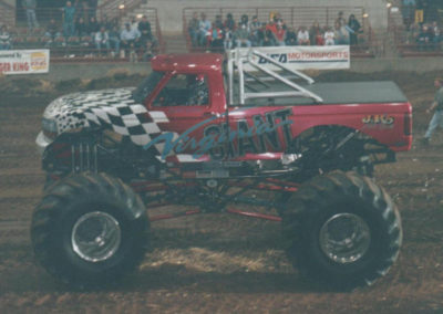 virginia giant monster truck with pink checkered flag